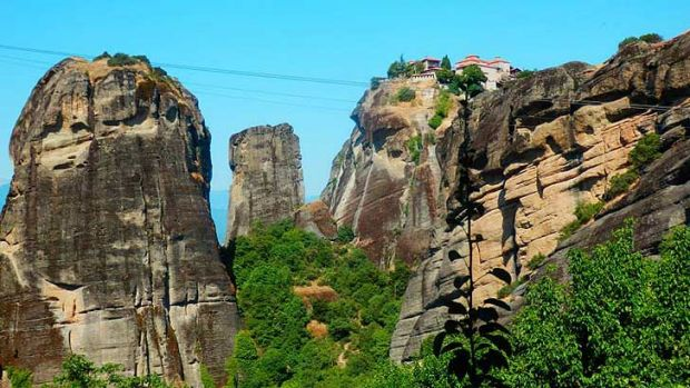 The Meteora 'suspended in the air' monasteries in central Greece were built atop towering natural sandstone pillars that ...
