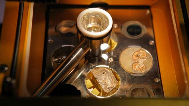 A laser ablation machine analysing the fossil.