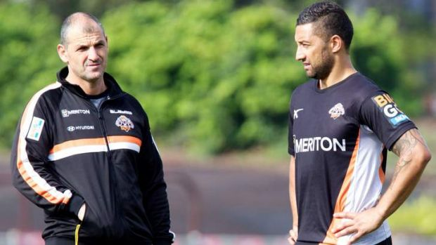 Mind is elsewhere: Benji Marshall with Tigers assistant coach Steve Georgallis at training on Tuesday.