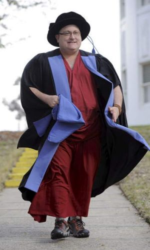 Associate Professor and Buddhist monk Alex Bruce received a PhD in Law on Wednesday.
