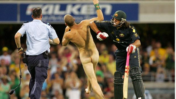 Andrew Symonds lets streaker Robert Ogilvie have it, unleashing a shoulder charge on the nude Brisbane mine worker ...