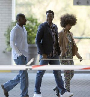 Ndaba Mandela, centre, grandson of former South African President Nelson Mandela, with two unidentified at the Medi ...