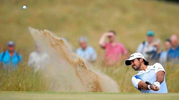 Jason Day of Australia hits from a bunker on the fifth hole during the first round of the British Open golf championship ...