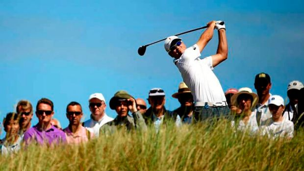 Zach Johnson of the United States tees off on the 14th hole during the first round of the 142nd Open Championship at ...