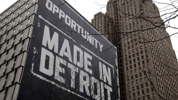 """A large """"Opportunity Made In Detroit"""" banner is seen on the side of a building in downtown Detroit, Michigan. The city ..."""