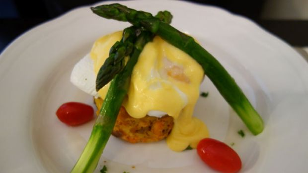"""A sweet vinaigrette """"made"""" the Atlantic salmon pattie and poached egg dish."""