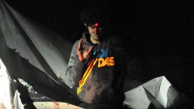 """This guy is evil"": Dzhokhar Tsarnaev emerges with a red dot on his forehead from a police rifle."