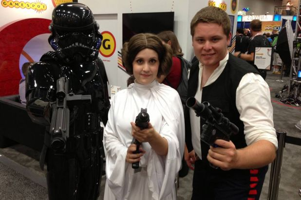 Fans dress (from left) as Darth Vader, Princess Leia and Han Solo from <i>Star Wars</i>, at Comic-Con.