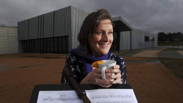 Musican and recorder specialist, Claire Taylor, 24 of Hawker, warms up with a mug of mulled wine as storm clouds gather ...
