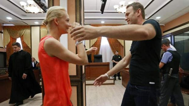 Surprise: Alexei Navalny embraces his wife Yulia after he was released.