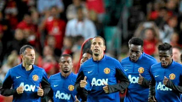 Painting the town red: Manchester United train before thousands at Allianz Stadium on Friday night.