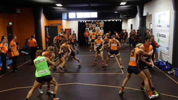 Warming up: Inside the dressing room of the GWS Giants team before the match starts, inset, Kevin Sheedy is ...