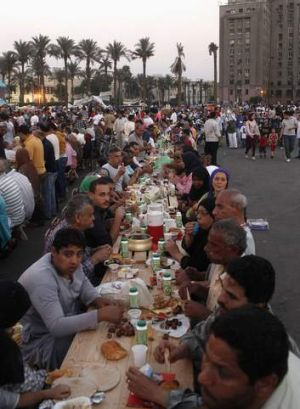 Families gather for a mass iftar (breaking fast) in Tahrir square, Waguih  earlier this month.