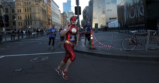 Participants running along Flinders Street during the Half Marathon of The Age Run Melbourne in St Kilda Road.