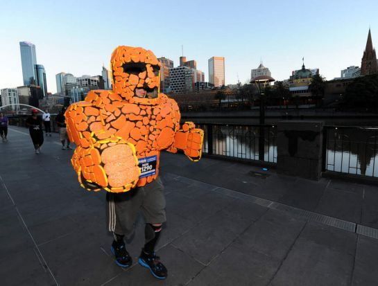 Participants running in a costume along South Bank during the Half Marathon of The Age Run Melbourne in St Kilda Road.