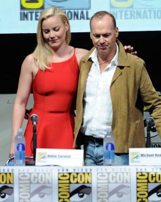 "Abbie Cornish and Michael Keaton speak onstage at the Sony and Screen Gems panel for ""RoboCop""."