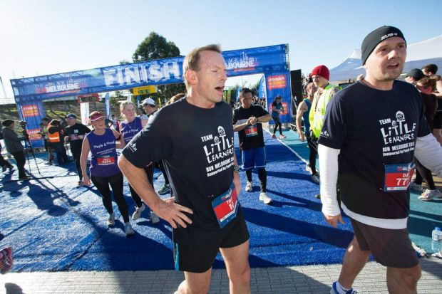 An exhausted Tony Abbott finishes the course.