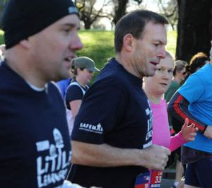 Tony Abbott puts the election race on hold to join in the fun run.