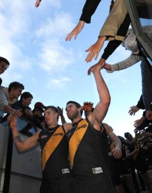 Finals bound: Chris Newman (right) and Dustin Martin high-five the fans after Richmond's win over Fremantle.