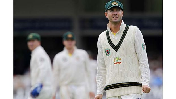 Oh, the pain: Australian captain Michael Clarke watches another English shot head for the boundary.