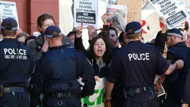 Protesters against the government's PNG plan for asylum seekers gather outside Balmain Town Hall, where Labor is holding ...