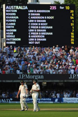 Sorry scoreboard: James Pattinson and Ryan Harris trudge off after their defiant last-wicket stand fell three balls ...