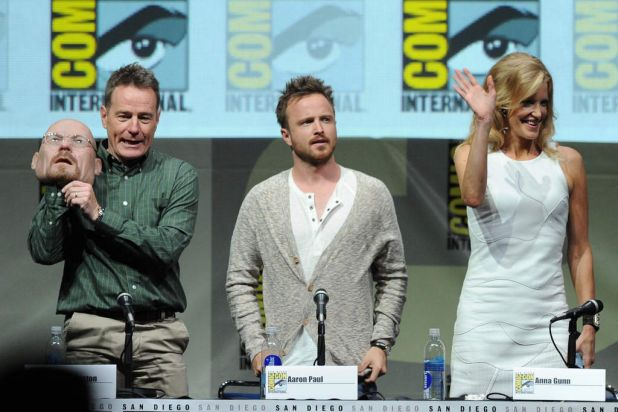 Actors Bryan Cranston, Aaron Paul, and Anna Gunn onstage at the <i>Breaking Bad</i> panel discussion, during Comic-Con.