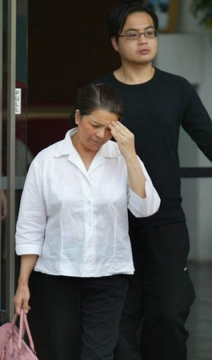 2005: Kim Nguyen leaving Singapore's Changi prison, with her son Khoa, after visiting her other son Nguyen Van Tuong, ...