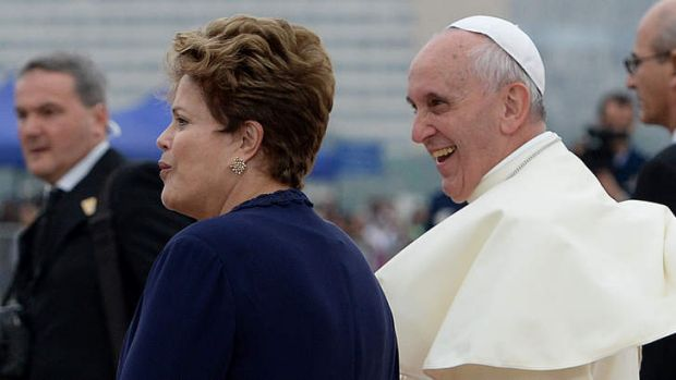 Pope Francis is welcomed by Brazilian President Dilma Rousseff upon landing at Rio de Janeiro's Galeao-Antonio Carlos ...