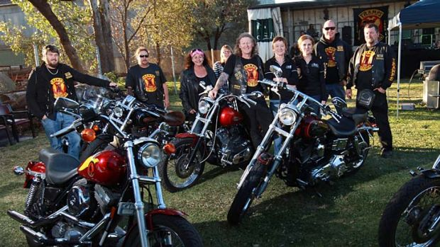 The Tramps' club members at a motorcycle gathering.