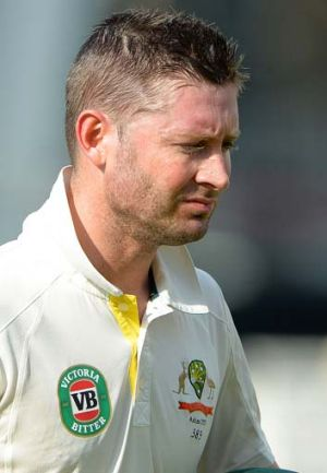 Bitter taste: Michael Clarke leaves the pitch after losing his wicket on the fourth day of play.