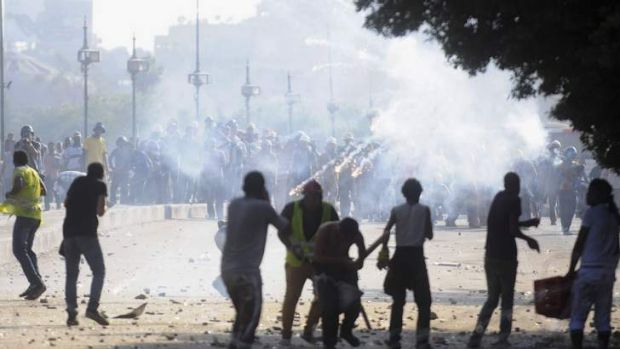 Flares are fired as members of the Muslim Brotherhood and supporters of ousted Egyptian President Mohamed Mursi clash ...
