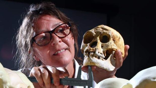 """See any resemblance? Susan Hayes holds a replica of the Homo floresiensis skull or the """"hobbit"""""""