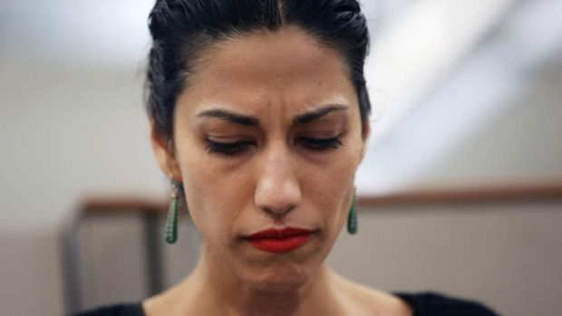 Huma Abedin, wife of Anthony Weiner, a leading candidate for New York City mayor, listens as her husband speaks at a ...