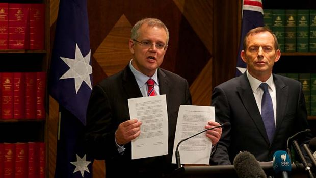 """Australian aid should never be a free gift"": Opposition Leader Tony Abbott (right), with immigration spokesman Scott ..."