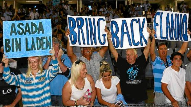 Signs of the times: Sharks supporters make their feelings felt about the ASADA investigation that targeted the club on ...