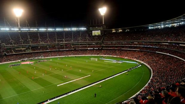 95,446 soccer fans crammed into the packed MCG to unite and sing the Liverpool anthem <i>You'll Never Walk Alone</i>.