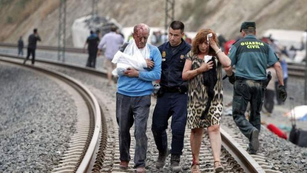 Victims are helped by rescue workers after a deadly train crash claimed at least 45 lives in Spain.