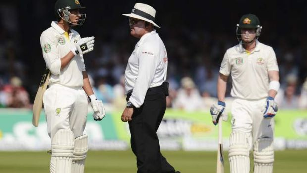 Ashton Agar (L) talks to umpire Marais Erasmus as he leaves the field at Lord's after being ruled out caught behind ...