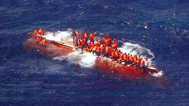 Risking all, including death: Asylum seekers on SIEV 358, which capsized on the way from Indonesia last year.