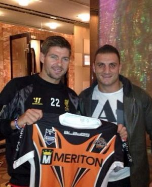 Presentation night: Steven Gerrard gets a Tigers jersey from Robbie Farah.