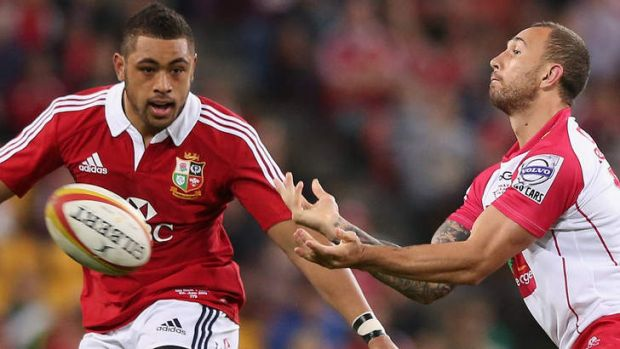 New chance: Quade Cooper (right) in action for the Reds against the Lions.