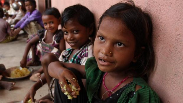 Puja and her classmates at Chatkari village in Bihar, in eastern India, eat their government-sponsored Midday Meal. The ...