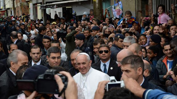 Pope Francis walks around the Varginha favela in Rio de Janeiro, a community of 1000 people which for decades was under ...
