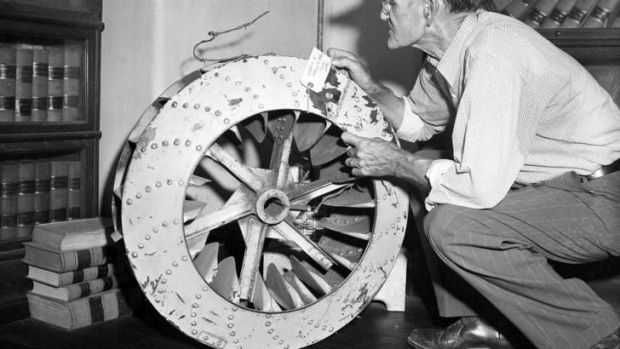 In this Sept. 22, 1955 file photo, a cotton-gin fan is presented as evidence in the trial investigating the death of ...