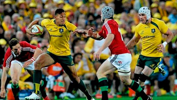 Holding off: Israel Folau impressed for the Wallabies against the British and Irish Lions.