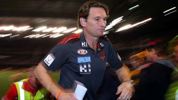 A grim-faced James Hird returns to the coaches' box after the three-quarter-time huddle.