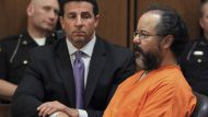 Ariel Castro (R), 53, sits in the court room next to his attorney Craig Weintraub in Cleveland, Ohio July 26, 2013.  ...
