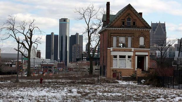 Desolation: A boarded up house of the once thriving Brush Park neighborhood stands in stark contrast to the downtown ...