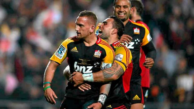 Aaron Cruden of the Chiefs celebrates with Liam Messam after scoring a try.